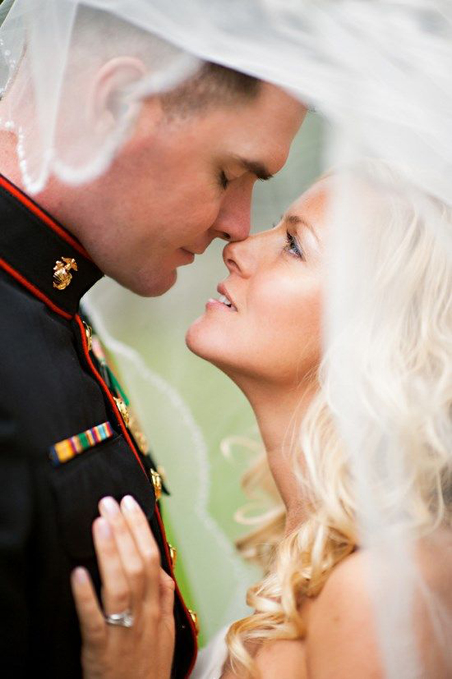 Bride looking up at her Marine.