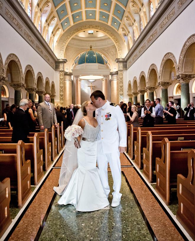 Bride kissing her Navy groom.
