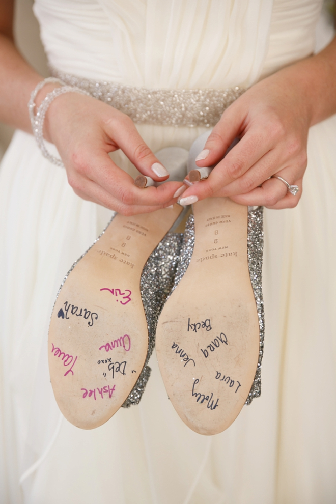 All the bridesmaids signed the bottom of the brides shoes!