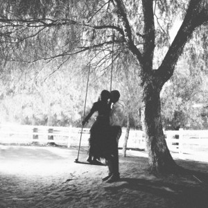 Super sweet kiss on a giant swing...