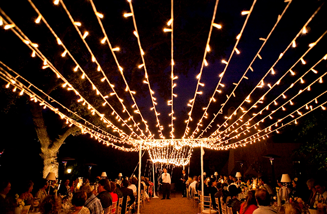 Line the aisle of the reception with twinkle lights
