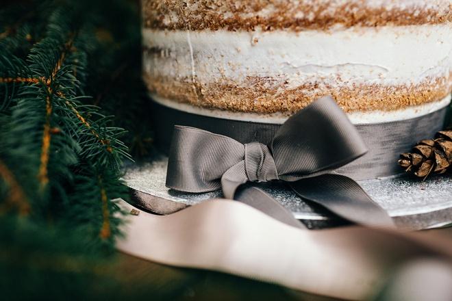 Adorable grey ribbon tied rustic wedding cake!