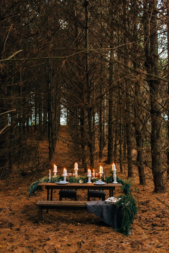 We love this gorgeous candle lit table in the forest!