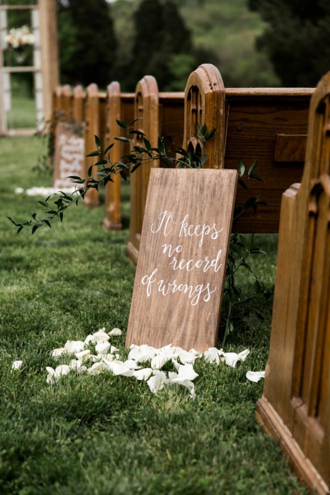 1 Corinthians signs along the wedding aisle.