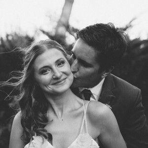 groom-kissing-bride-featured