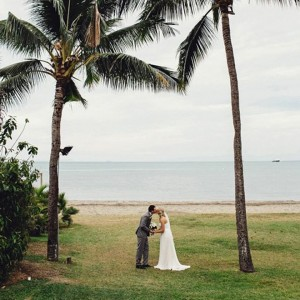 bride-and-groom-on-the-beach-featured