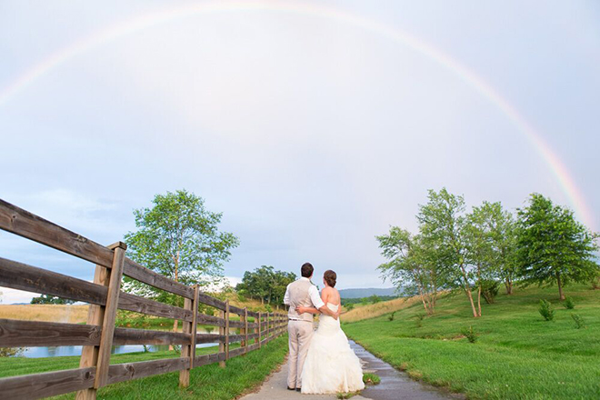 Amazing shot of bride and groom under a full rainbow!