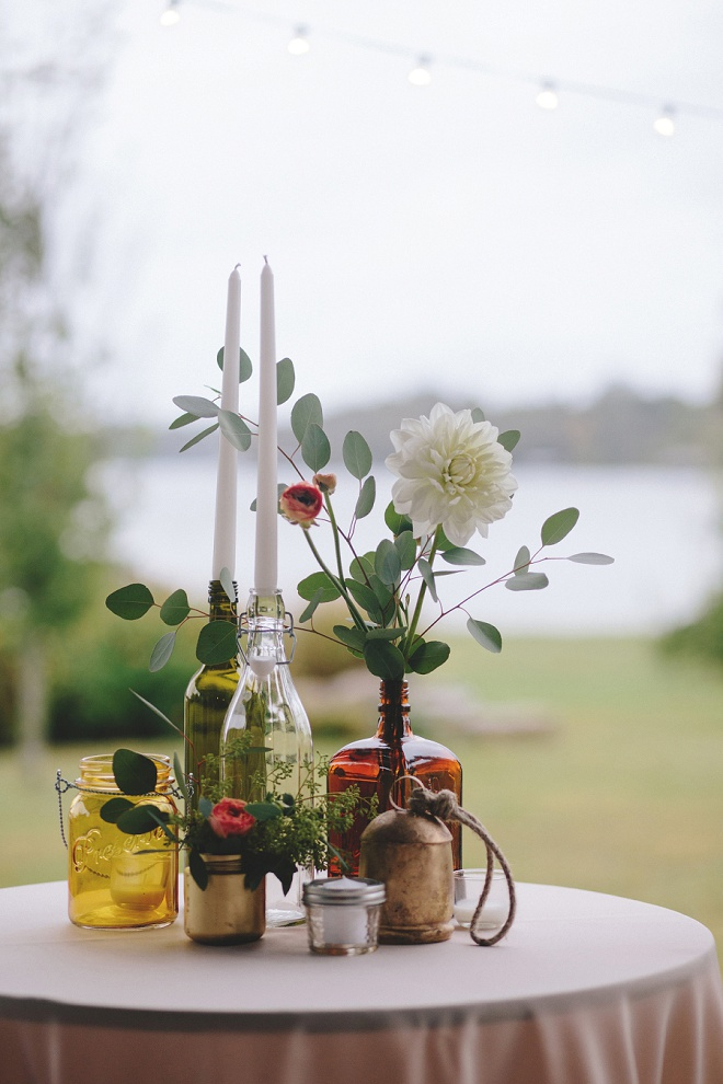 Mismatched, hand painted bottles and flowers for cocktail table centerpieces!
