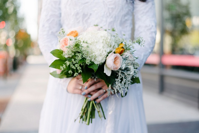 We're loving this bride's garden rose bouquet and vintage long sleeve dress!