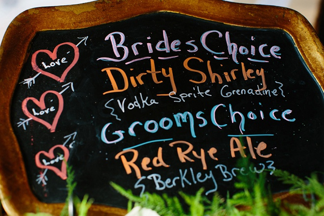 Loving this handpainted chalkboard drink menu at this fun DIY wedding!