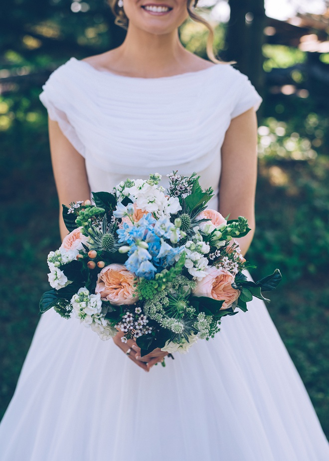 LOVING this gorgeous bouquet featuring a blue flower in memory of the Bride's mother.