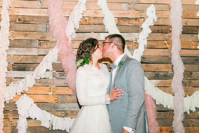 We're loving this gorgeous shot of the Bride and Groom in their DIY photo booth!