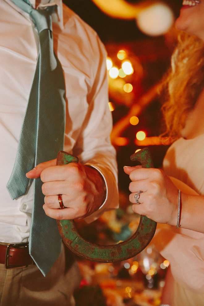 Swooning over this gorgeous Bride and Groom ring and horseshoe shot of the Mr. and Mrs!