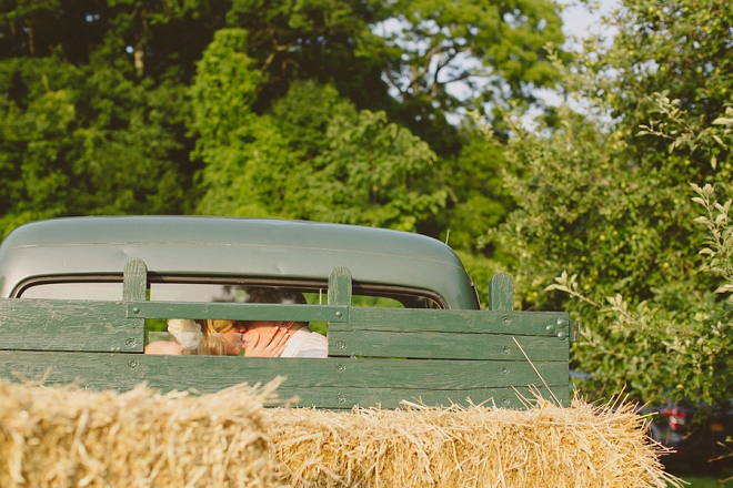 How fun is this Bride and Groom kissing shot in their vintage truck! So fun!