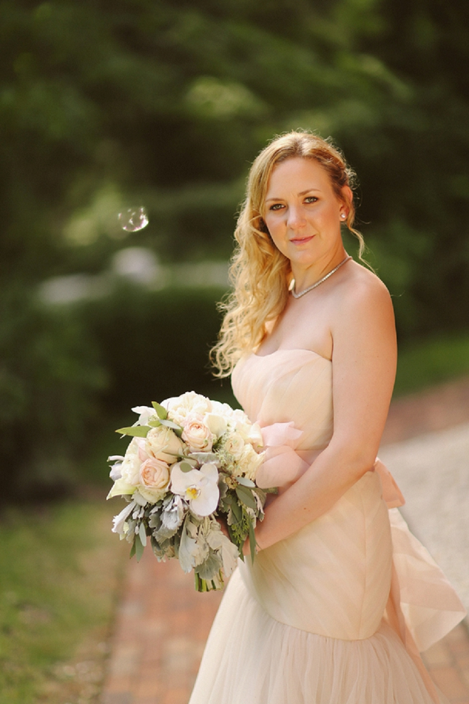 Loving this gorgeous Bride's blush dress and beautiful bouquet!