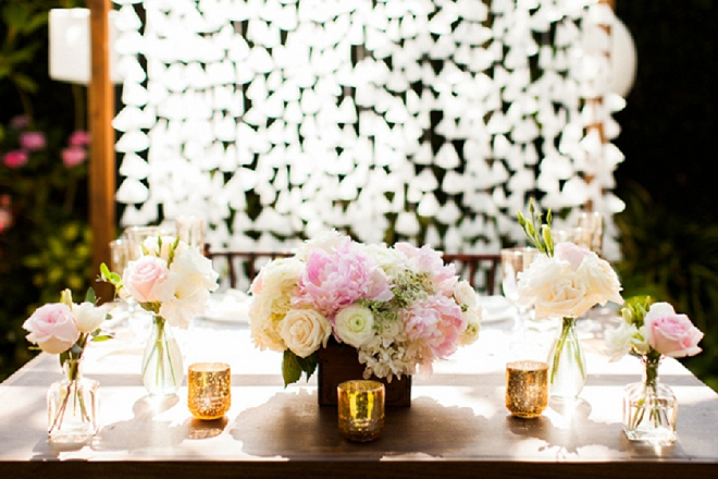 Swooning over this gorgeous sweetheart table and their gorgeous DIY backdrop!