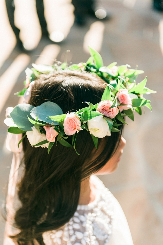How darling is this flower girl in her gorgeous flower crown?! So cute!