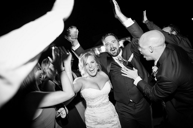Such a fun snap of the new Mr. and Mrs. leaving their reception!