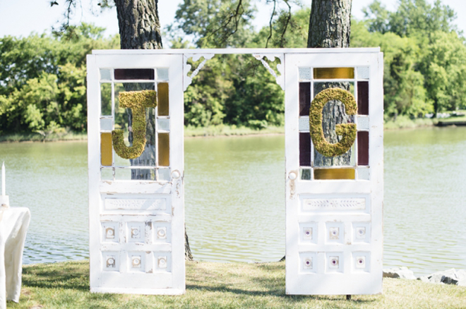 How darling are these barn doors and monograms on this rustic outdoor wedding ceremony!
