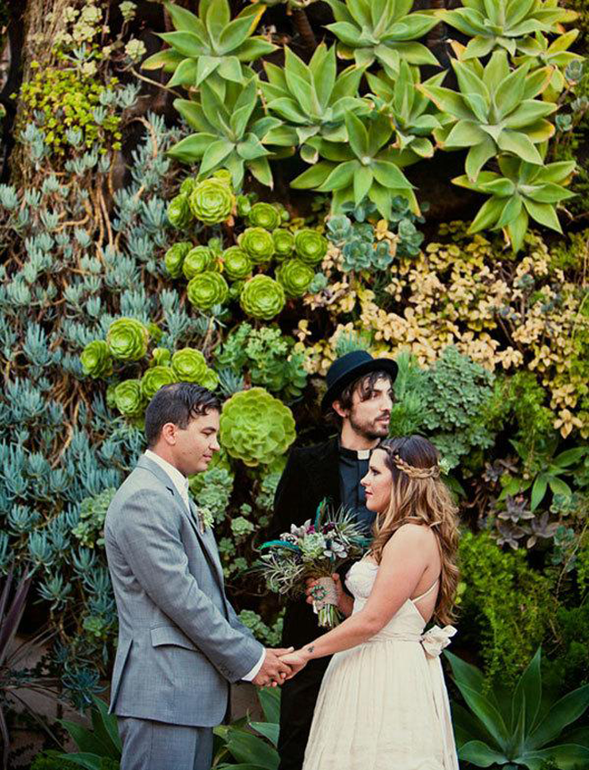 Gorgeous succulent backdrop for this outdoor ceremony!