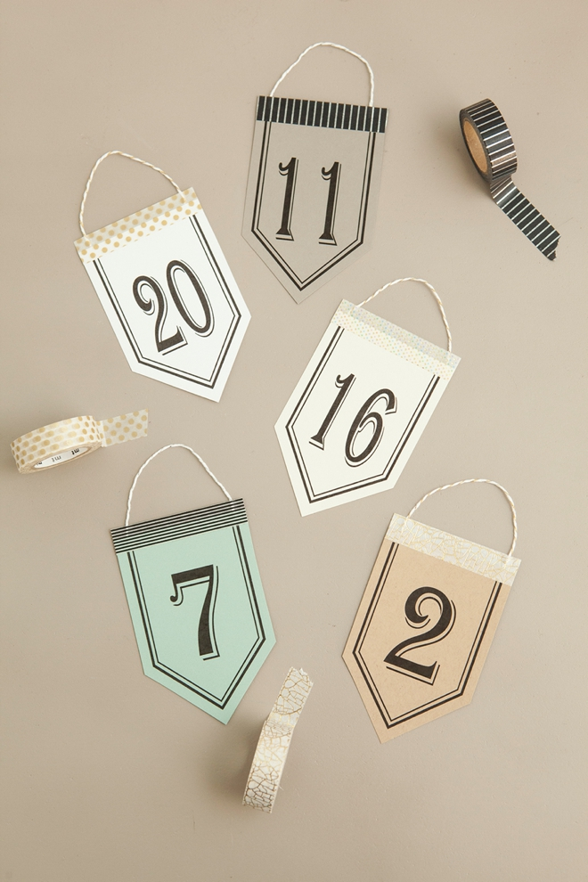 Check out these unique, DIY hanging table number stands with free printable numbers!