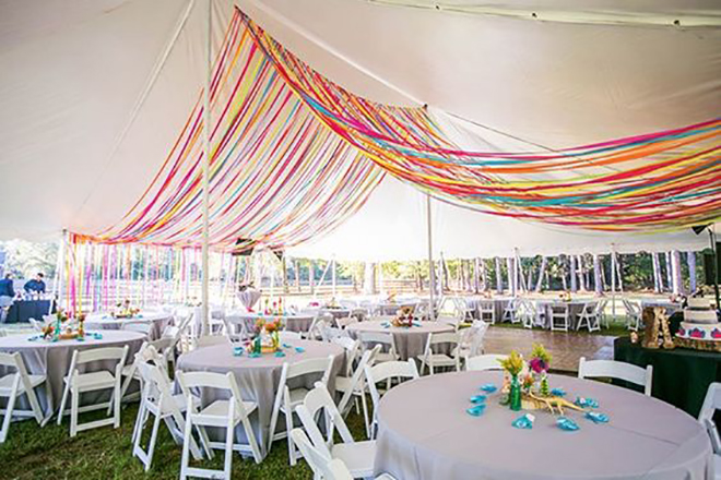 ribbon is a whimsical way to add color to a wedding tent