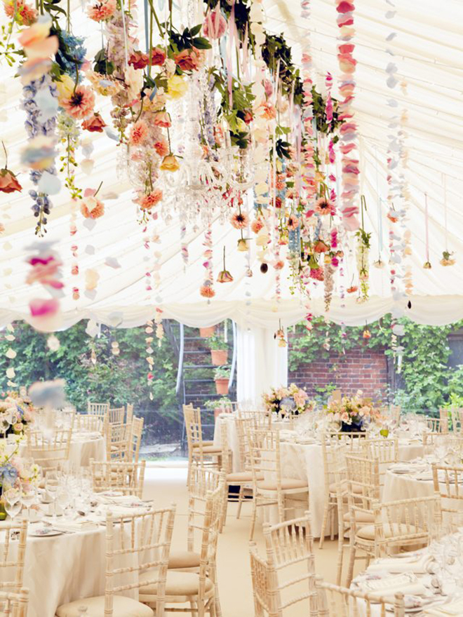 whimsical floral garlands strung from a tent is the perfect way to brighten up the space