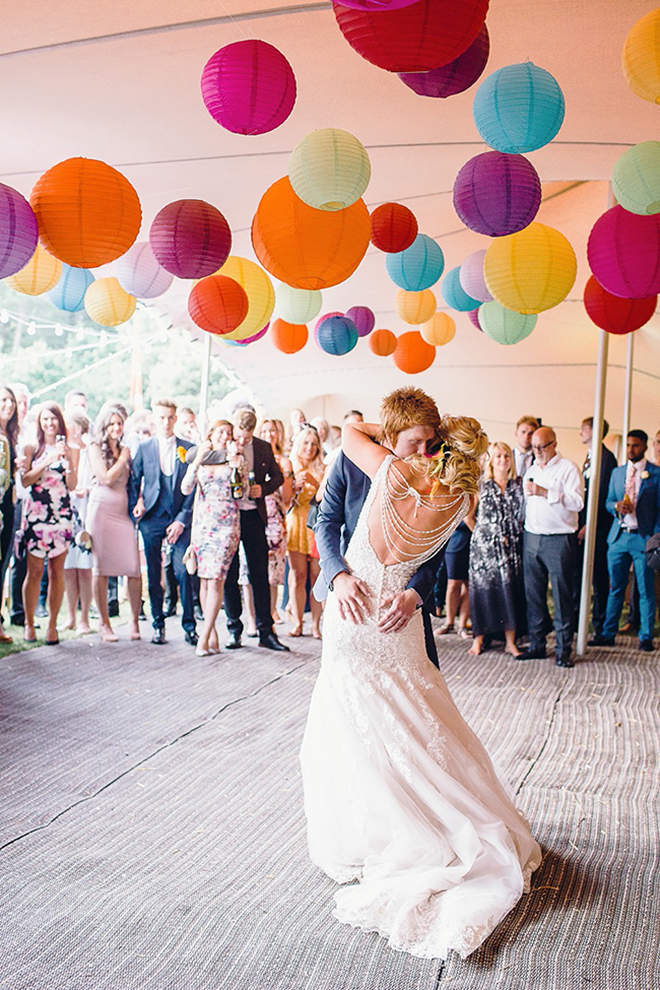Colorful paper lanterns pop against a white tent