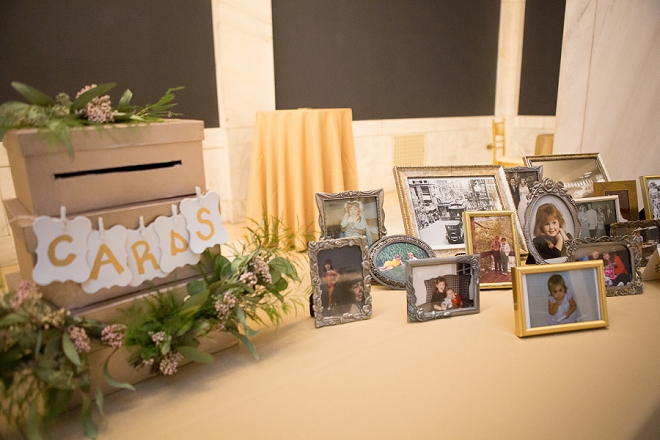 We're loving this darling card box and family photos at this DIY museum reception!