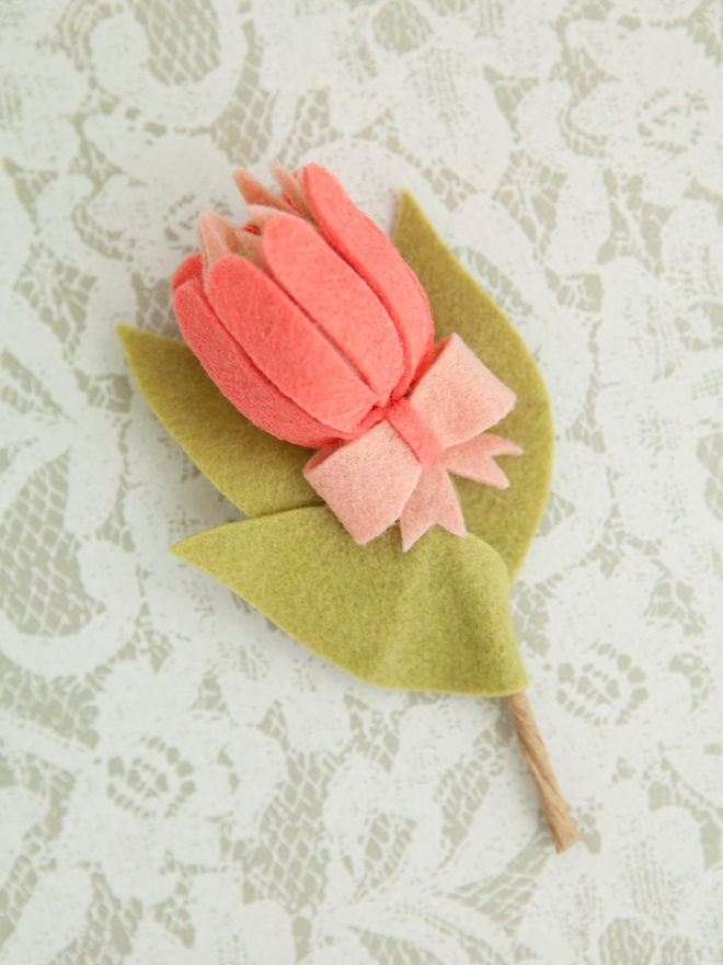 The most darling felt protea boutonniere!