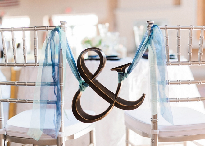 We love this sweet Mr. and Mrs. chair sign at this gorgeous wedding!