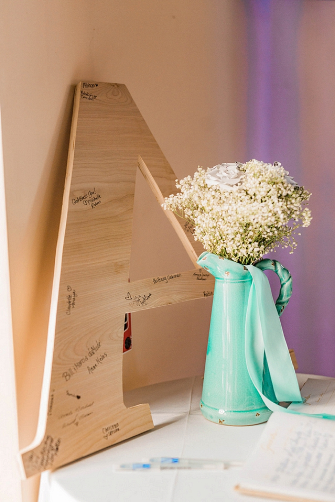 Loving this cute monogram guest book at this gorgeous wedding!