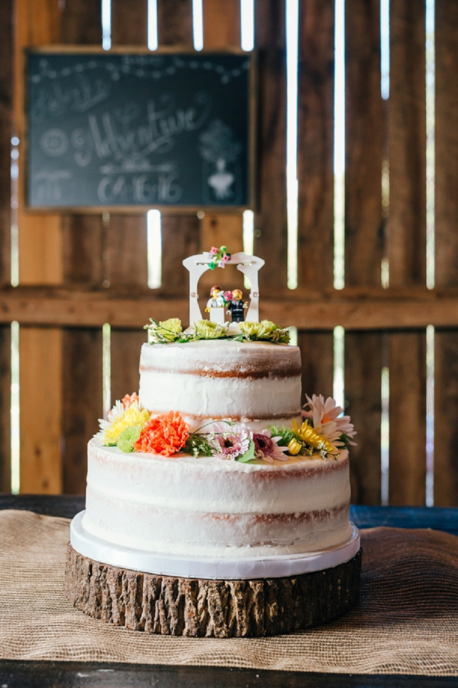 We're loving this fun couple's wedding cake and darling cake topper!