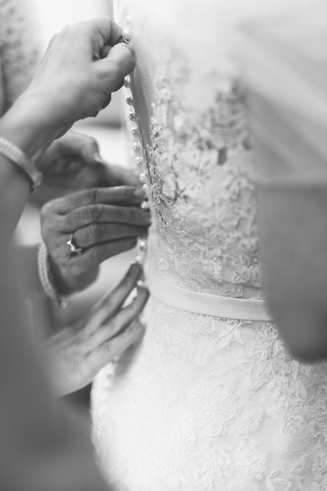We're crushing on this gorgeous shot of the Bride getting ready for the big day!