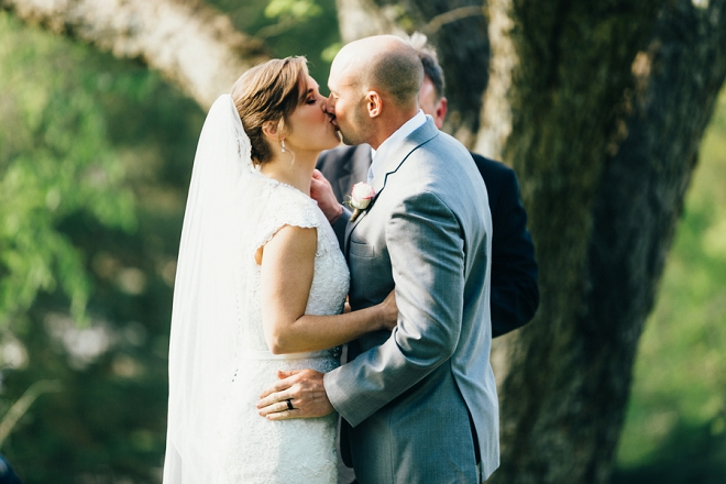 Crushing on this darling couple's first kiss as Mr. and Mrs!