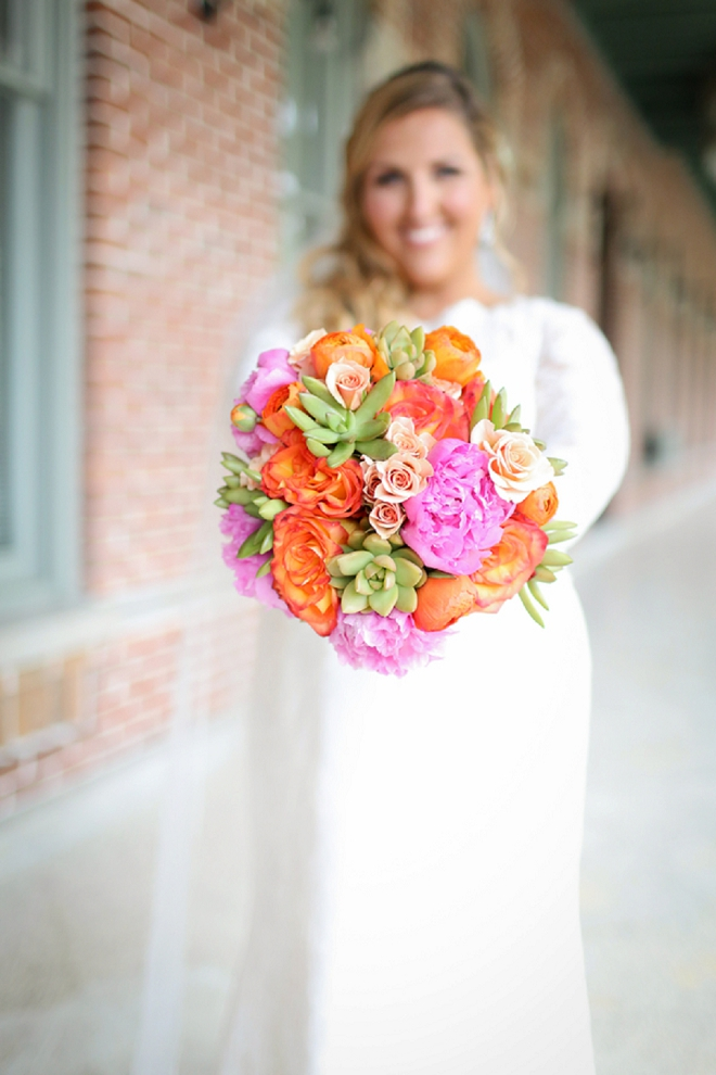 The stunning Bride and her colorful bouquet before the ceremony!