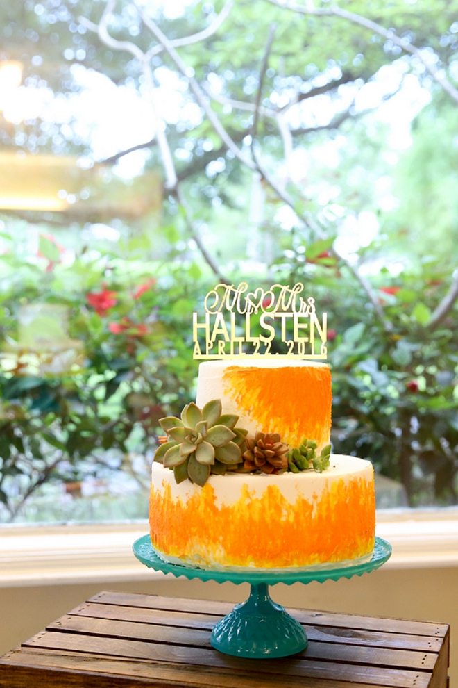 Crushing on this couple's bright and gorgeous wedding cake and gold personalized cake topper!