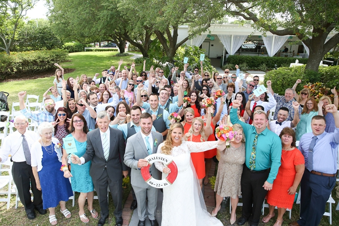 What a great photo of the Bride and Groom and their entire wedding!