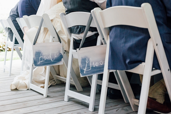 Crushing on this stunning Bride and Groom chair signs!