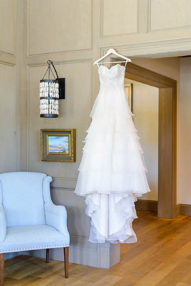 We're in LOVE with this dress shot at this stunning coastal wedding!