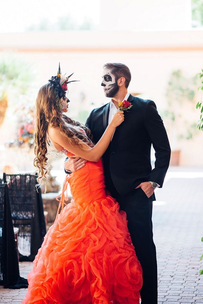 Check out this stunning Day of the Dead styled wedding and this gorgeous red dress!
