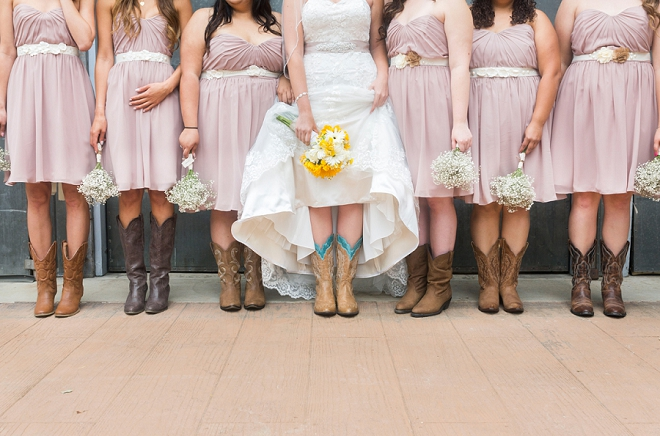 We LOVE this Bride and her Bridesmaid's cowgirl boots for the big day!