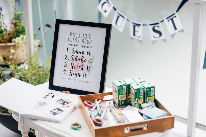 A polaroid wedding guest book! So easy and a unique guest book idea.