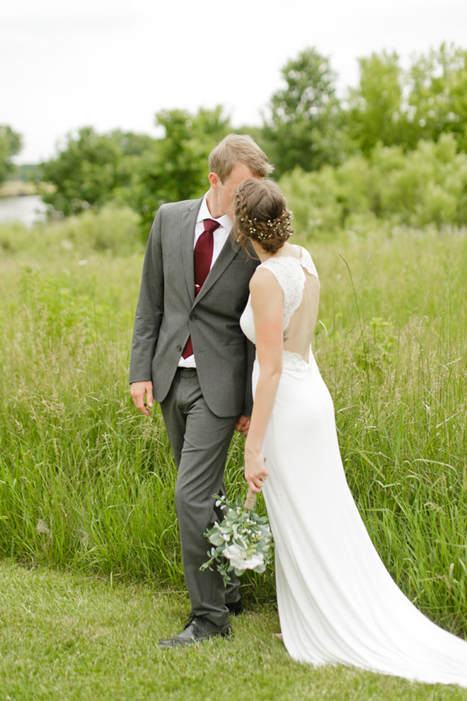 Gorgeous shot of the bride and groom kissing by The Siegers Photo and Video!