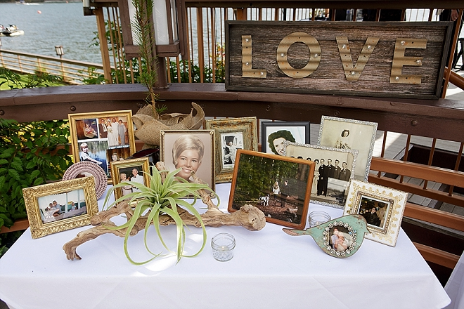 Loving the family photo table at this couple's wedding reception!