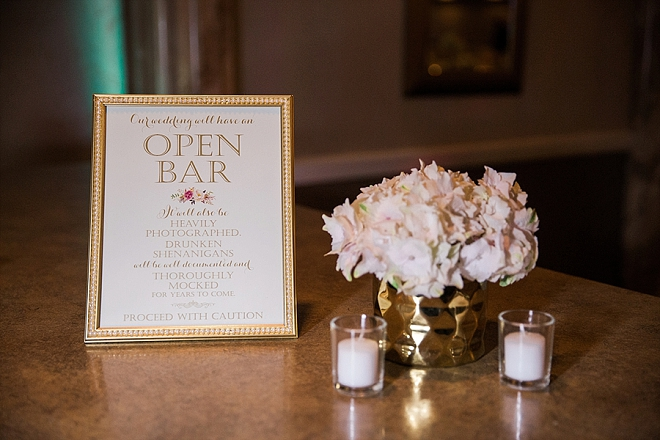 Such a cute open bar sign with cute gold accents!