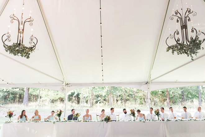 We LOVE this stunning reception image of the head table!