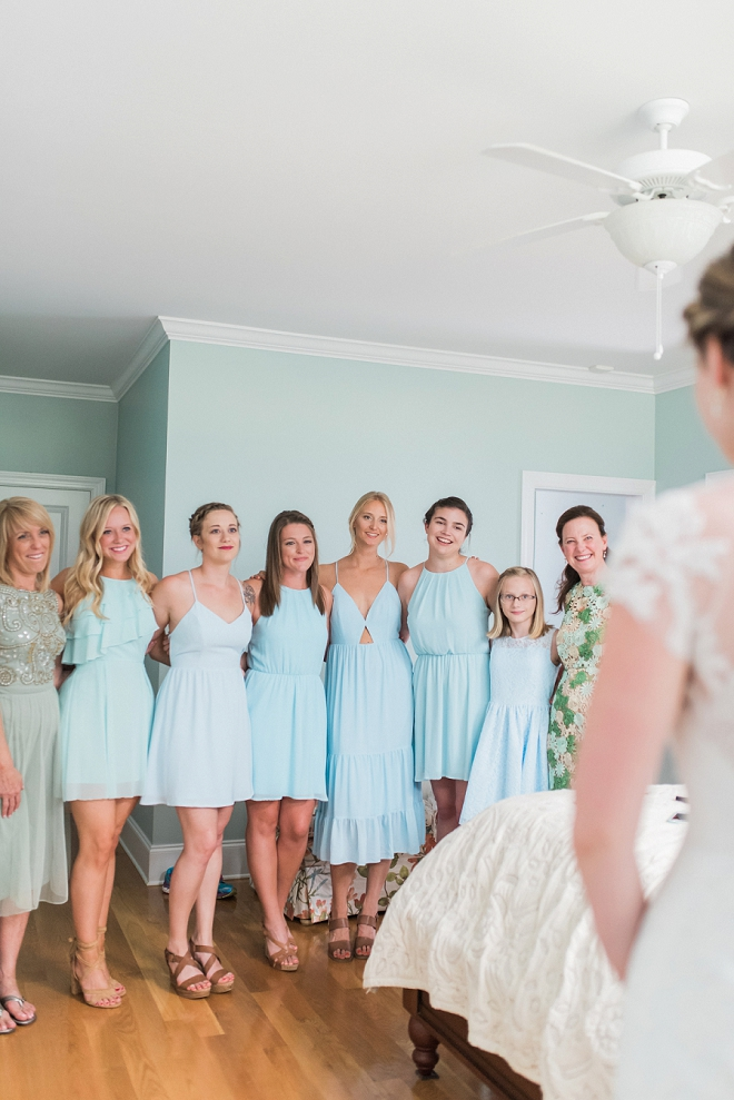 How sweet is this snap of the Bride showing her bridesmaid's her dress! LOVE!