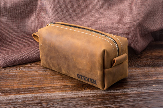 We love this warm leather monogrammed toiletry bag perfect for the man in your life!