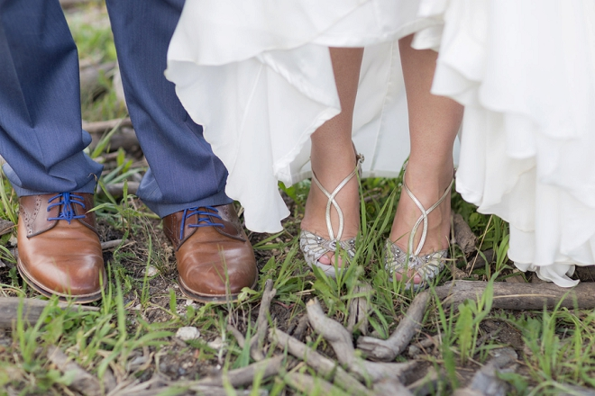 We love this sweet snap of the Bride and Groom's shoes!